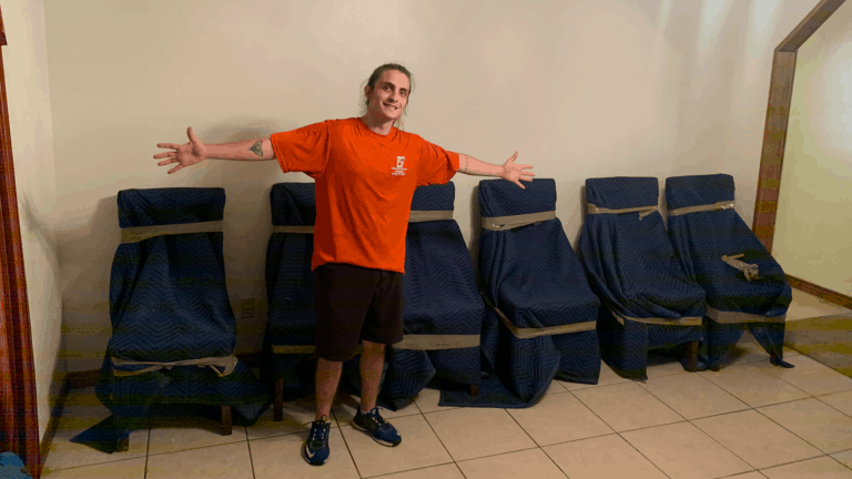 Simplified Moving Solutions team member with chairs