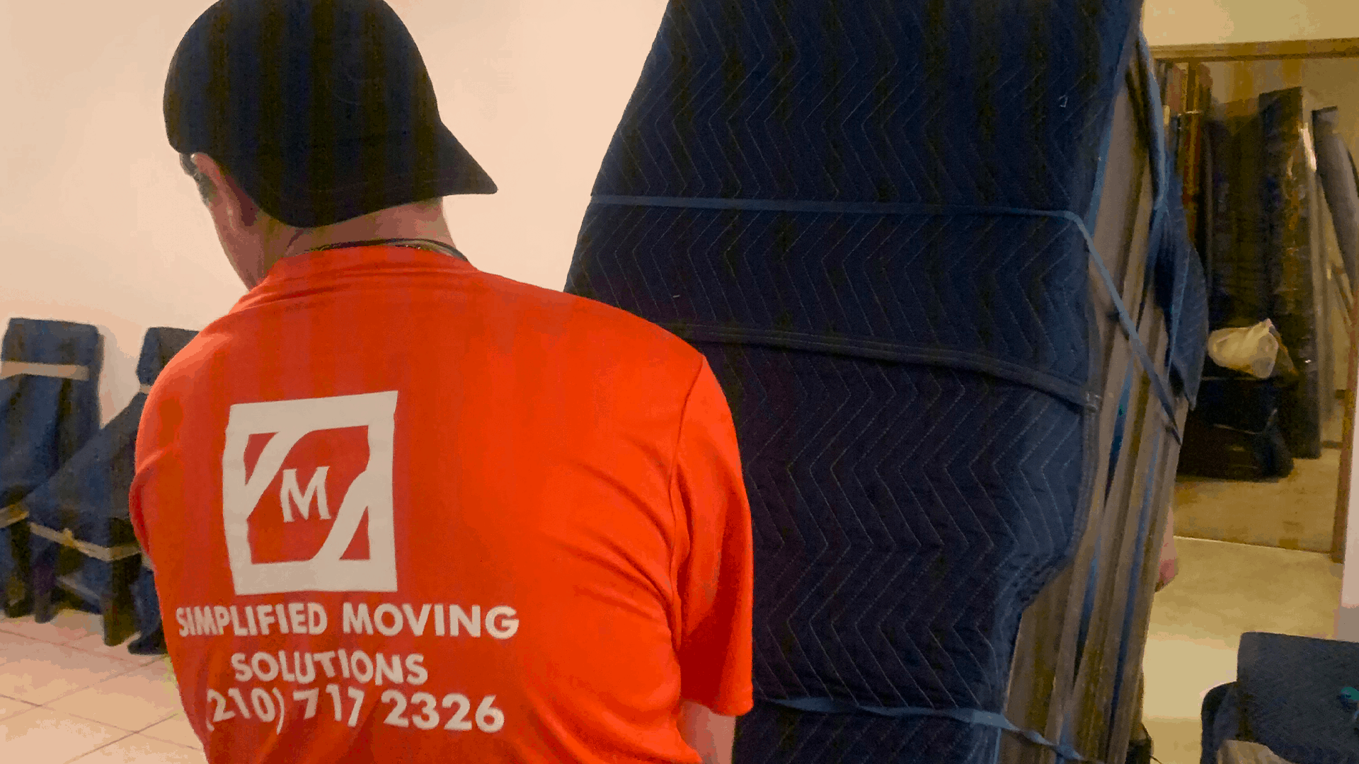 Simplified Moving Solutions crew moving large furniture