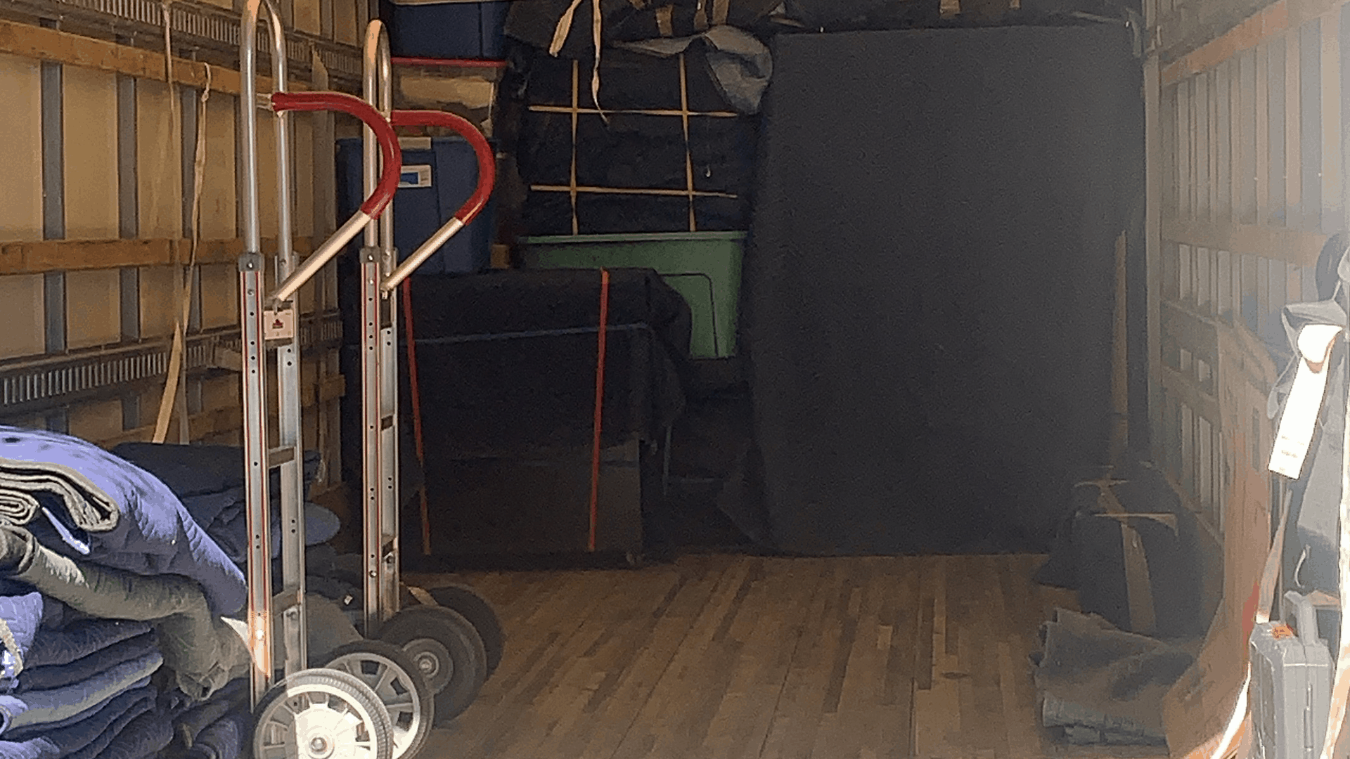 Image inside of moving truck with dollies