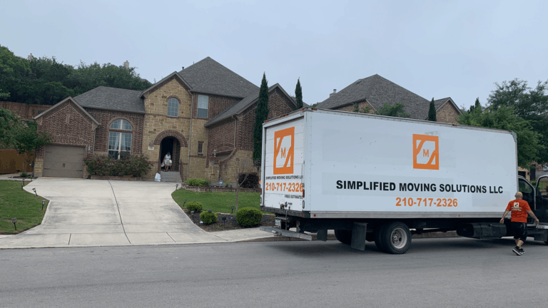 Pictured: large moving truck parked outside of residential house