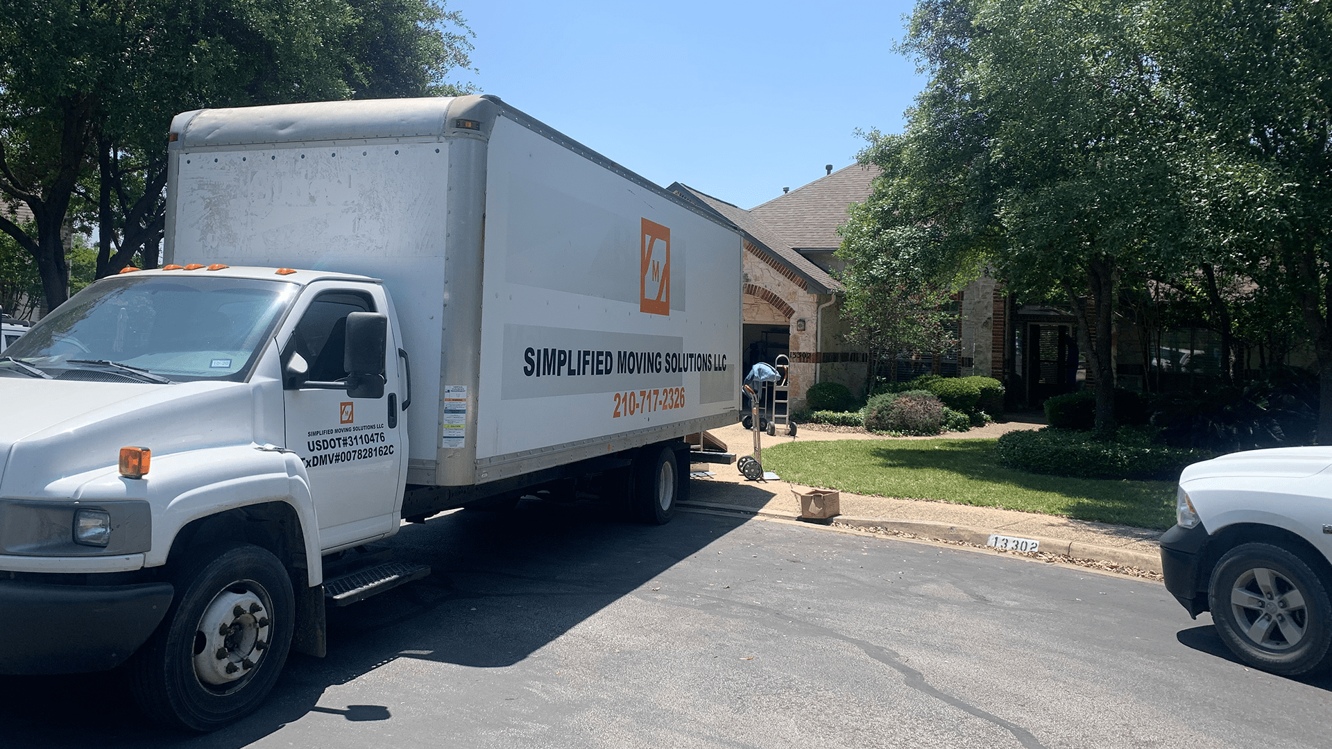 Image of large moving truck parked at house