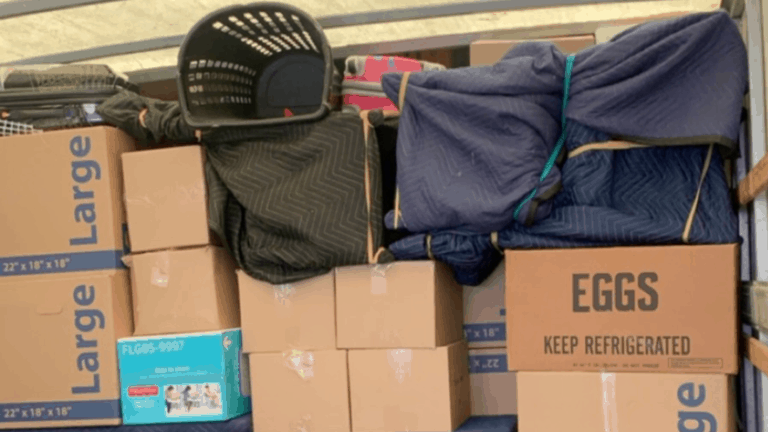 Moving boxes and items packed in moving truck