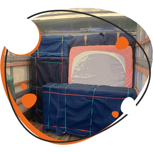 Image of padded furniture in moving truck