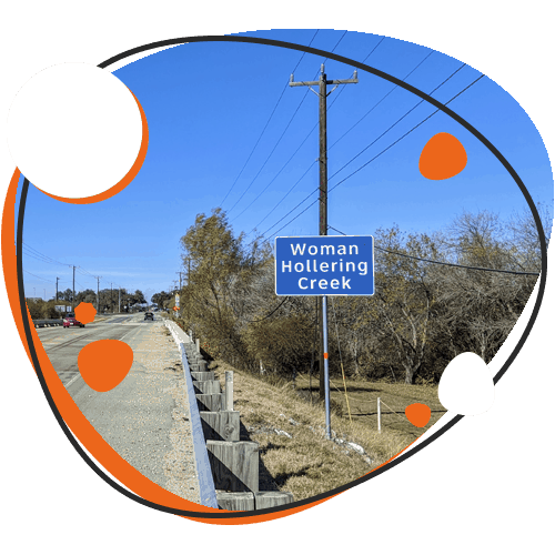 Image of S. Woman Hollering Creek road sign